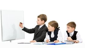 Little business man showing smth to little business people. Little business men showing something on screen to the group of little business people, isolated on royalty free stock photography