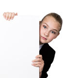 Little business woman standing behind and leaning on a white blank billboard or placard, expresses different Royalty Free Stock Photos
