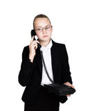 Little business woman talking on a phone, screaming into the phone. Studio portrait of child girl in business style Royalty Free Stock Photos