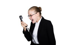 Little business woman talking on a phone, screaming into the phone. Studio portrait of child girl in business style Royalty Free Stock Image