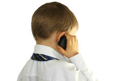 Little businessman. Talking on cell phone Royalty Free Stock Image