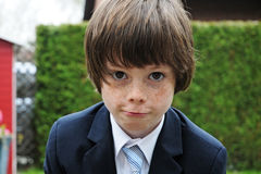 Little businessman. Cute little boy dressed like a businessman pull faces Royalty Free Stock Photo