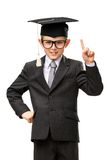 Little businessman in academic cap forefinger gesturing. Half-length portrait of little businessman in academic cap forefinger gesturing, isolated on white stock image