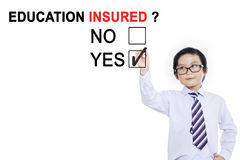 Little businessman approving with education insured Stock Images