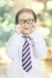 Little businessman with bokeh background Stock Images