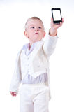 Little businessman in a business suit with phone. Stock Photos