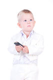 Little businessman in a business suit with phone. Royalty Free Stock Images