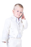 Little businessman in a business suit with phone in hand Royalty Free Stock Photos