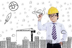 Little businessman drawing Royalty Free Stock Photo