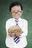 Little businessman holds brain Royalty Free Stock Photography
