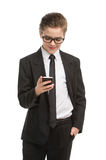 Little businessman with mobile phone. Royalty Free Stock Image