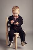 Little businessman with mobile phone Royalty Free Stock Photo