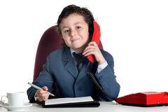 Little businessman in the office Royalty Free Stock Photos
