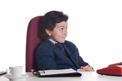 Little businessman in the office Royalty Free Stock Image