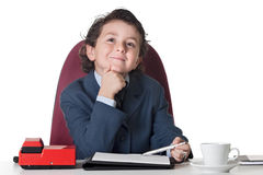 Little businessman in the office stock photo