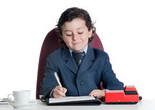 Little businessman in the office Stock Photos