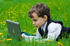 Little businessman outdoors Royalty Free Stock Photos
