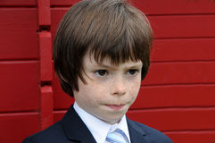 Little businessman. Pensive little boy dressed like a businessman Royalty Free Stock Images