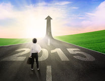 Little businessman on the road to future 2015 Royalty Free Stock Photo