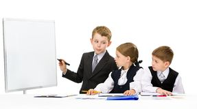 Little businessman showing smth to little business people Stock Images