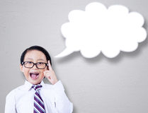 Little businessman and speech bubble Royalty Free Stock Images