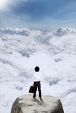 Little businessman standing on the mountain Royalty Free Stock Photography