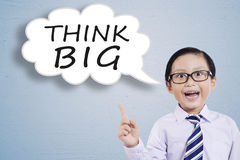 Little businessman and Think Big text Royalty Free Stock Images