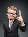 Little businessmen in spectacles forefinger gesturing Stock Image