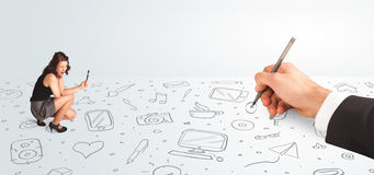 Little businesswoman looking at hand drawn icons and symbols Stock Photography