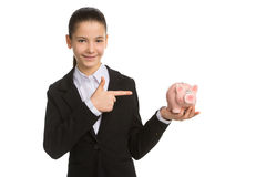 Little businesswoman with piggy bank. Royalty Free Stock Image
