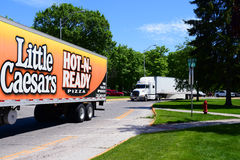 Little Caesars Convoy. KALISPELL, MONTANA, USA - May 23, 2017: A Little Caesars Pizza semi-truck convoys with another semi through the streets of Kalispell Royalty Free Stock Images