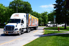Little Caesers Truck. KALISPELL, MONTANA, USA - May 23, 2017: A Little Caesars Pizza semi-truck convoys with another semi through the streets of Kalispell Stock Photos