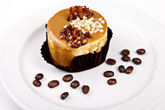 Little cake with caramel and nuts Royalty Free Stock Photos