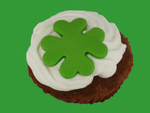 Little cake with cream and green cloverleaf Royalty Free Stock Image