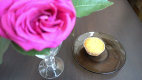 Little cakes and rose on wooden table on Valentine's Day. Love the concept of romance. stock video footage