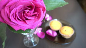 Little cakes and rose on wooden table on Valentine's Day. Love the concept of romance. stock video
