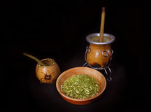 Little calabaza and porongo with yerba mate cup. Little calabaza and porongo near yerba mate cup -  on the black background Royalty Free Stock Photography