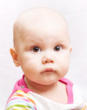 Little calm brown eyed baby Stock Images