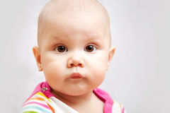 Little calm brown eyed Caucasian baby closeup Stock Photography