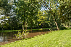 Little canal with grass shore. At Brugge, Belgium Royalty Free Stock Photography