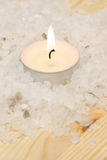 Little Candle in Bath Salt Royalty Free Stock Photo