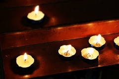 Little candles in a church, miniature style Stock Images