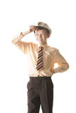 Little captain. Smiling and squinting boy standing in captain cap over white Stock Images