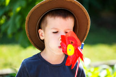 Little carefree boy with spinning flower Stock Photography