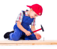 Little carpenter nailing Stock Image