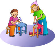 Little carpenters. Boy and girl working, and making two seats Stock Photo