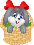 Little cartoon rabbit sitting in a bucket Stock Photo