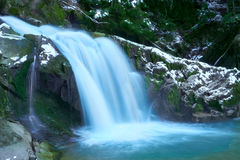 Little cascade with ice and icicles Royalty Free Stock Images