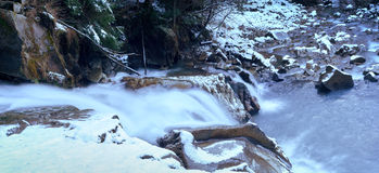Little cascade with ice and icicles Royalty Free Stock Photo