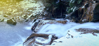 Little cascade with ice and icicles Royalty Free Stock Photos